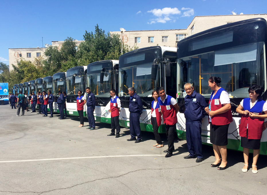 Drivers with the new fleet of green buses in Kazakhstan