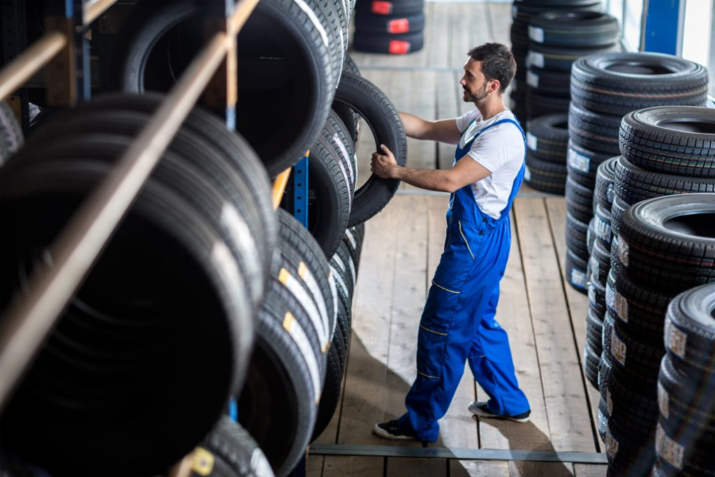 A worker in a tyre factory
